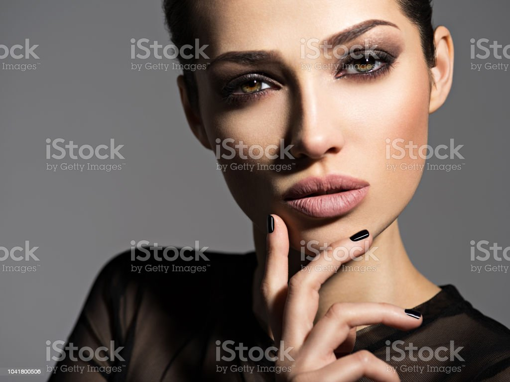Face of a beautiful girl with smoky eyes makeup stock photo