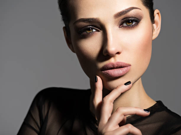 face of a beautiful girl with smoky eyes makeup - glamour stock pictures, royalty-free photos & images