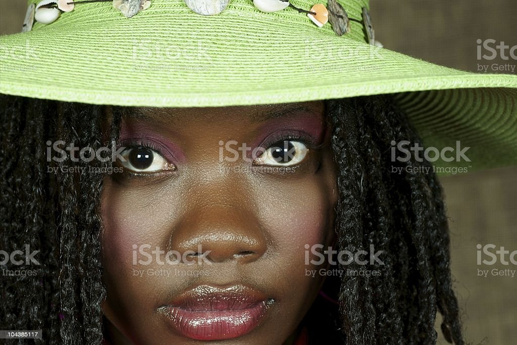 face of a black woman with green hat royalty-free stock photo