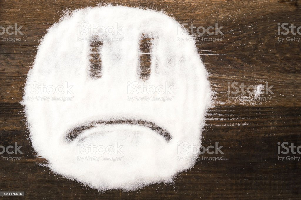 Face of a sad smiley made with granulated sugar royalty-free stock photo