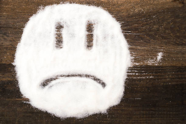 Face of a sad smiley made with granulated sugar stock photo