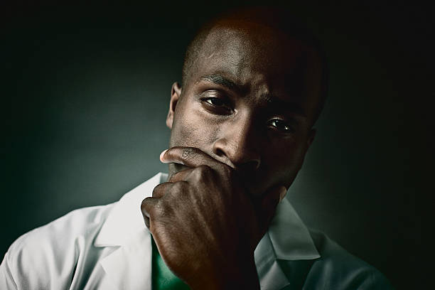 face of a weary doctor stock photo