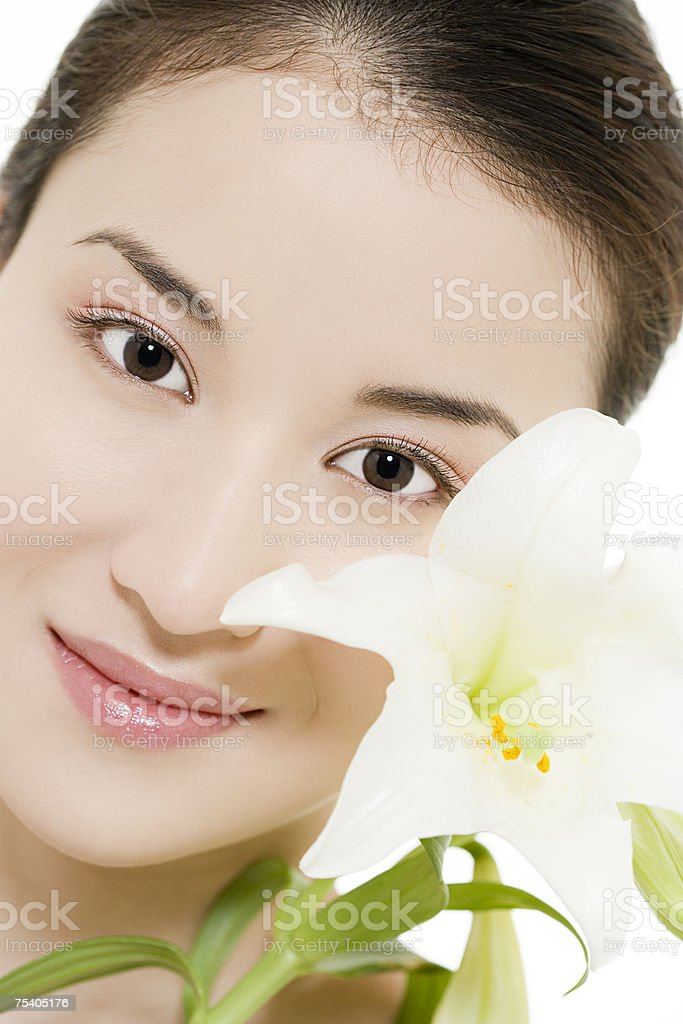 Face of a woman with lily royalty-free stock photo