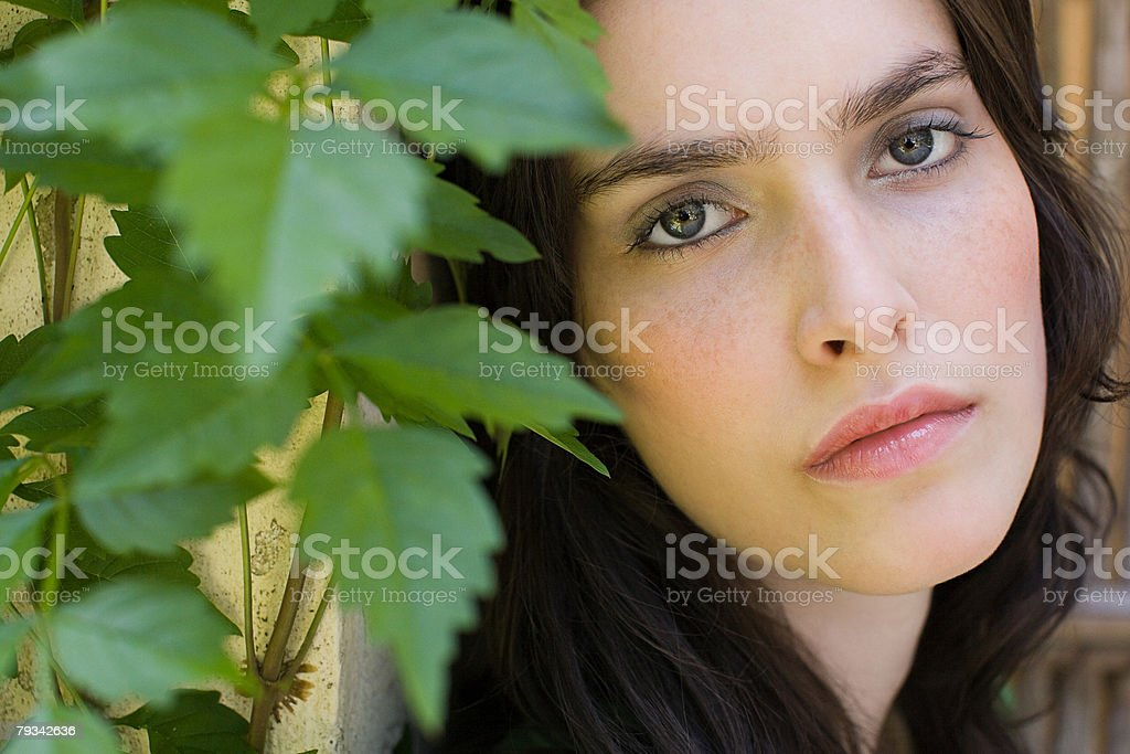 Face of a young woman with leaves 免版稅 stock photo