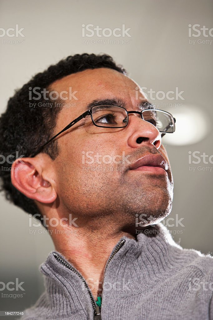 Face of African American man wearing eyeglasses stock photo