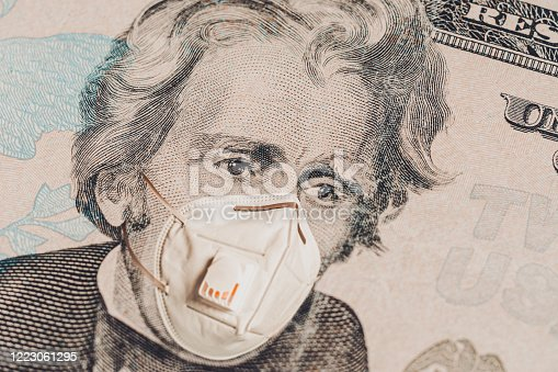 Face of american president in medical mask on dollar bill during economic crisis and pandemic of coronavirus. Realistic and quality montage with currency concept 2021