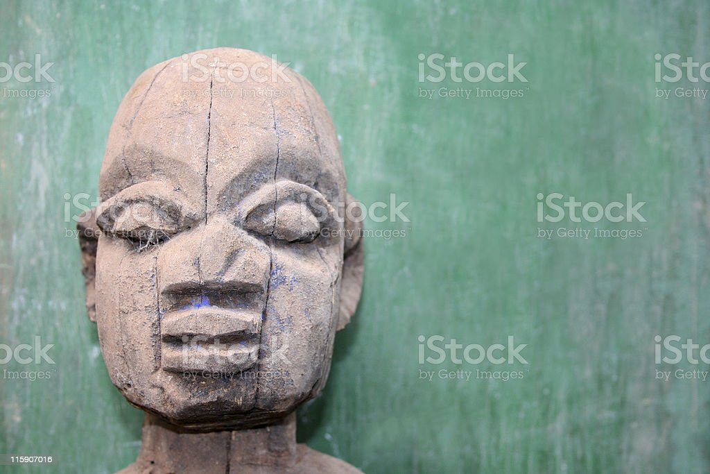 face of an african totem stock photo