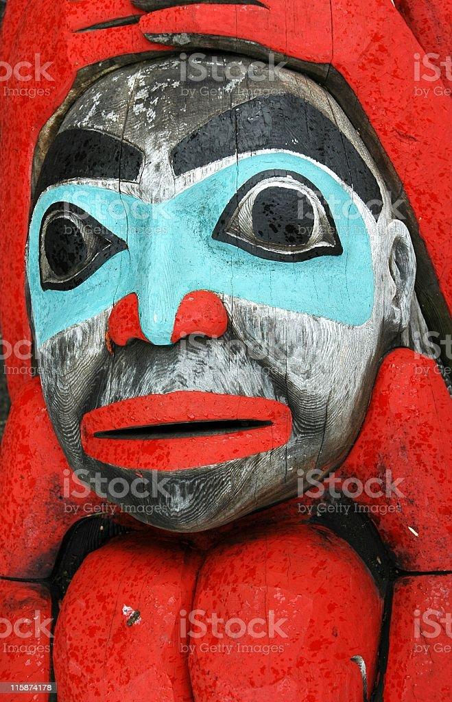 Face of an Alaskan totem pole. stock photo