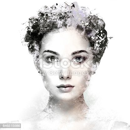 istock Face of beautiful woman decorated with flowers 646515586