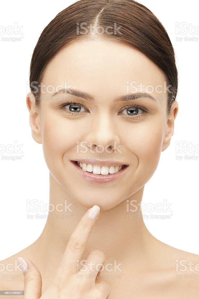 face of beautiful woman touching her chin stok fotoğrafı