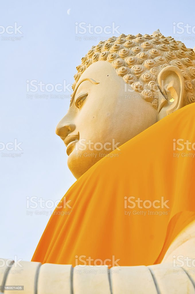 Face of big sandstone buddha statue royalty-free stock photo