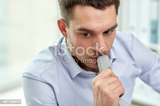 istock face of businessman with phone receiver in office 487795976