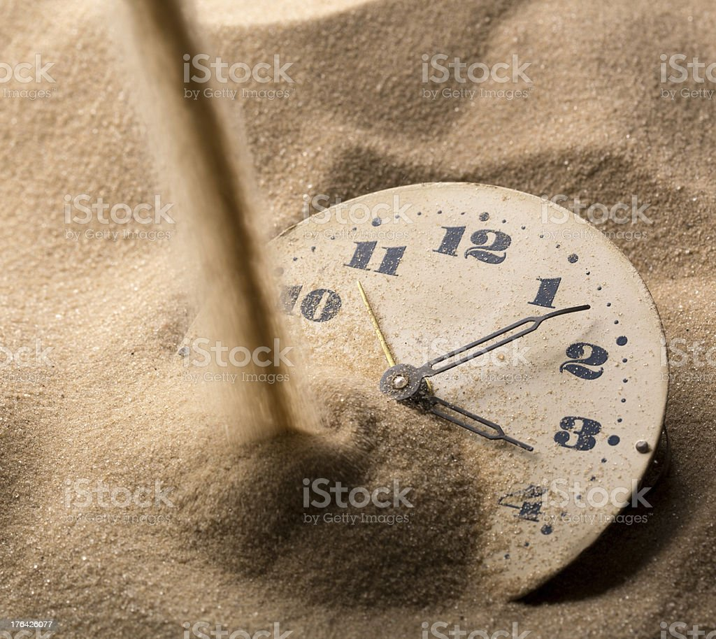 Face of clock in sand royalty-free stock photo
