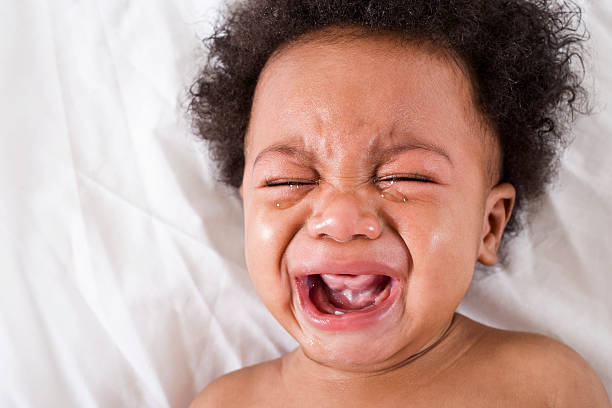 Face of crying African American baby stock photo