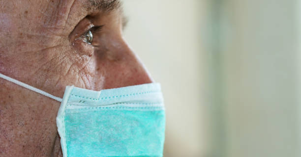 Face of elderly man wearing medical facemask picture id1219556190?b=1&k=6&m=1219556190&s=612x612&w=0&h=pfgwsczeoyrfvmgaryzkv9xv3ck jk9631ww7v ft4m=