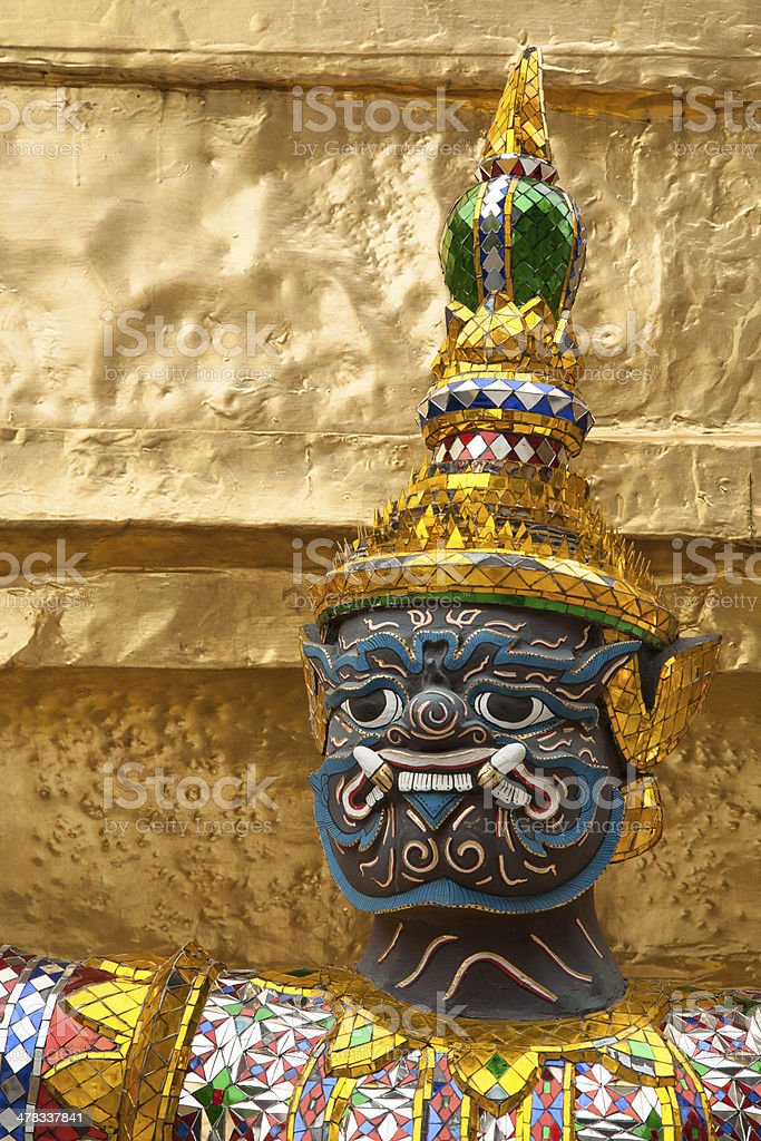 Face of green demon guardian sculpture protect gold pagoda royalty-free stock photo