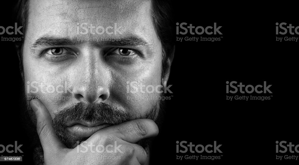 Face of handsome intelligent confident man stock photo