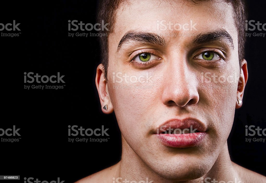 Face of handsome sensual man isolated on black royalty-free stock photo