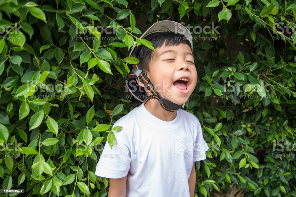 Face of happy asian boy in the garden. royalty-free stock photo