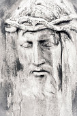istock Face of Jesus Christ, old stone statue, black and white, copy space 1199073450