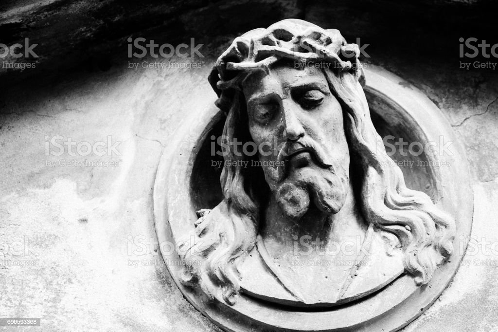 Face of Jesus Christ on a tomb stock photo