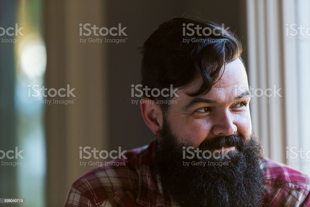 Face of man with black hair and long beard stock photo