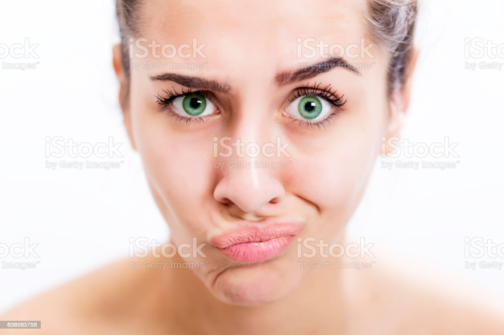 Face of serious young woman with beautiful color of eyes stock photo