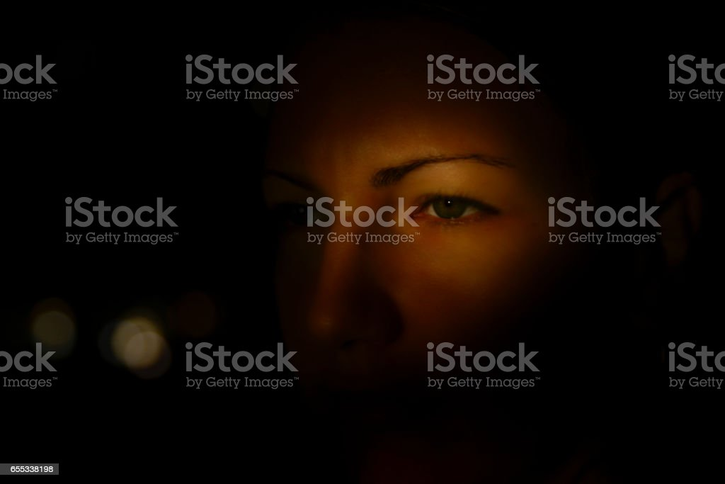 Face of woman in darkness eye stock photo