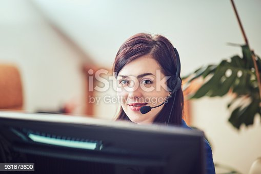 istock Face of young charming confident woman with headset 931873600