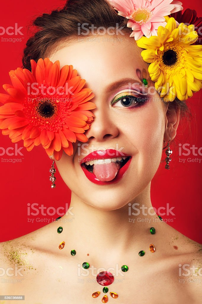face of  young girl with fantasy makeup on red background royalty-free stock photo