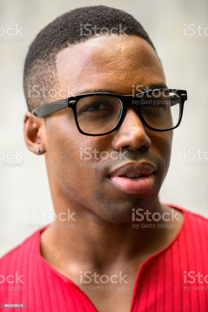 4ef5951aeb11 Face of young handsome African man wearing eyeglasses royalty-free stock  photo