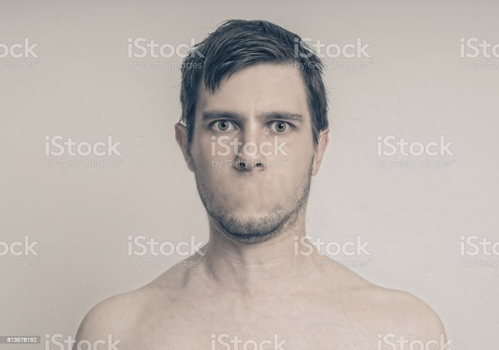 Face of young man without mouth. Censorship concept. stock photo