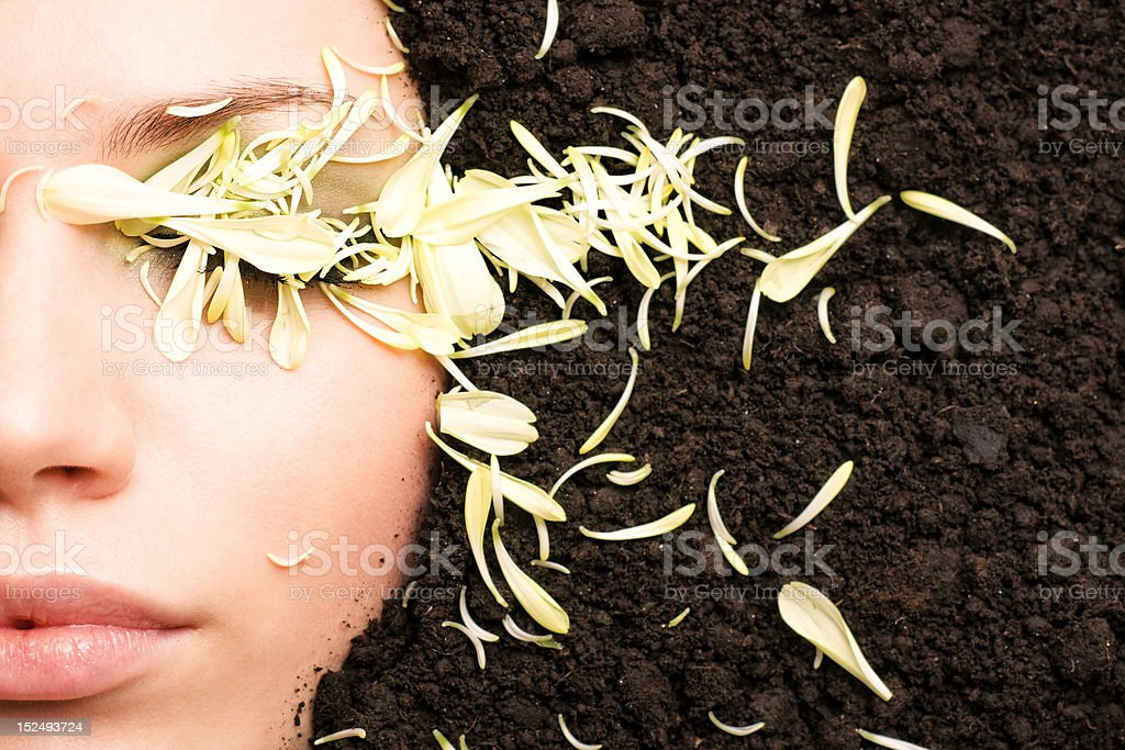 Face of young woman in the soil. Close-up. royalty-free stock photo