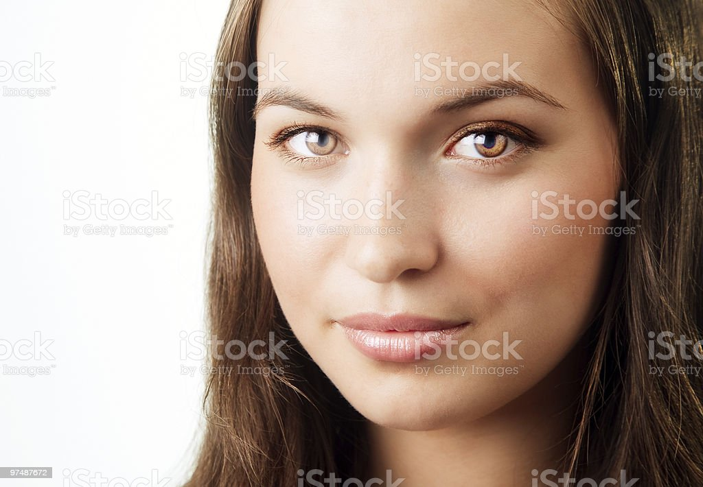 Face of young woman with beautiful bright eyes royalty-free stock photo
