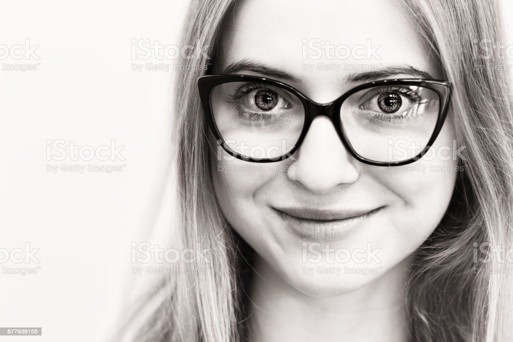 face of young woman with black glasses royalty-free stock photo