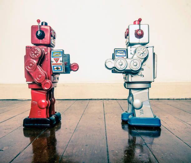 face off robots - battle stock photos and pictures