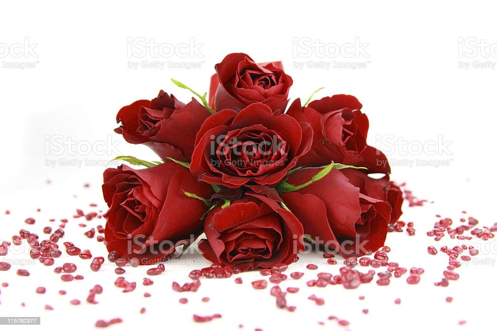 Face on red roses bouquet and small beads royalty-free stock photo