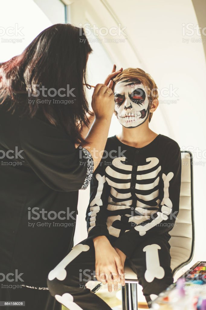 Face paint process royalty-free stock photo
