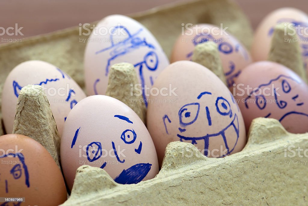 Face painted eggs royalty-free stock photo