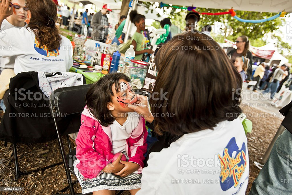 face painting at festival stock photo