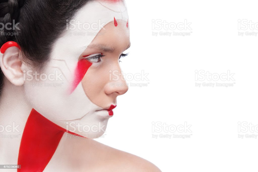 Face Painting in Japan style. Body art colorful make-up. Geisha isolated on white background with copy space. royalty-free stock photo
