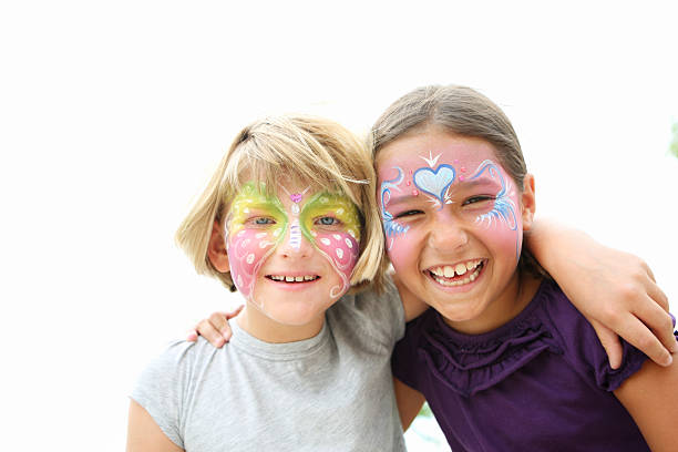 face paited kids - school fete stock photos and pictures