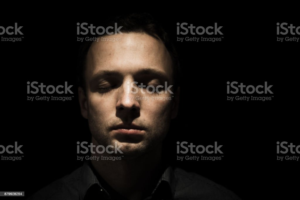 Face portrait of young man with closed eyes stock photo