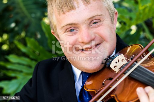 istock Face shot of handicapped violinist outdoors. 507140750