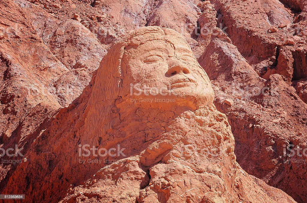 Face silhoutte in the cliff. stock photo