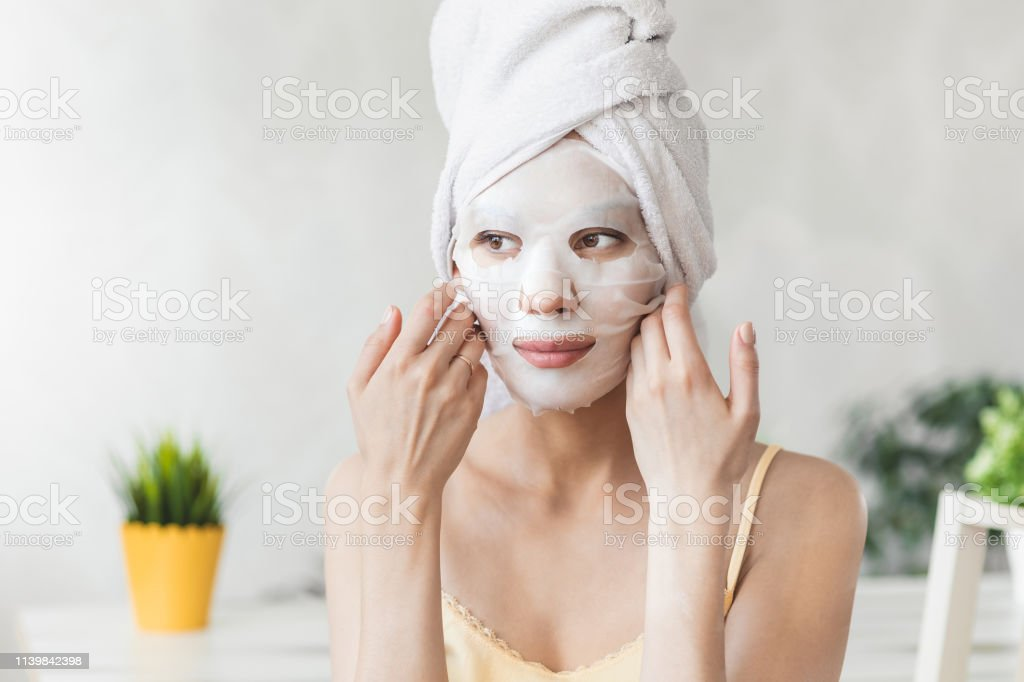 Face Skin Care Attractive Young Woman Wrapped In Bath Towel With White Moisturizing Face Mask Skin Care Concept Girl Taking Care Of Complexion Beauty Treatments Stock Photo Download Image Now Istock