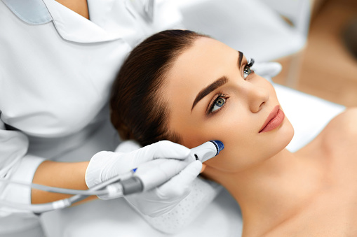 https://media.istockphoto.com/photos/face-skin-care-facial-hydro-microdermabrasion-peeling-treatment-picture-id501398516?k=6&m=501398516&s=170667a&w=0&h=dhYazb59OC7uCMrxULduSZt6rf7yoWb0lWuxp5XBFKk=