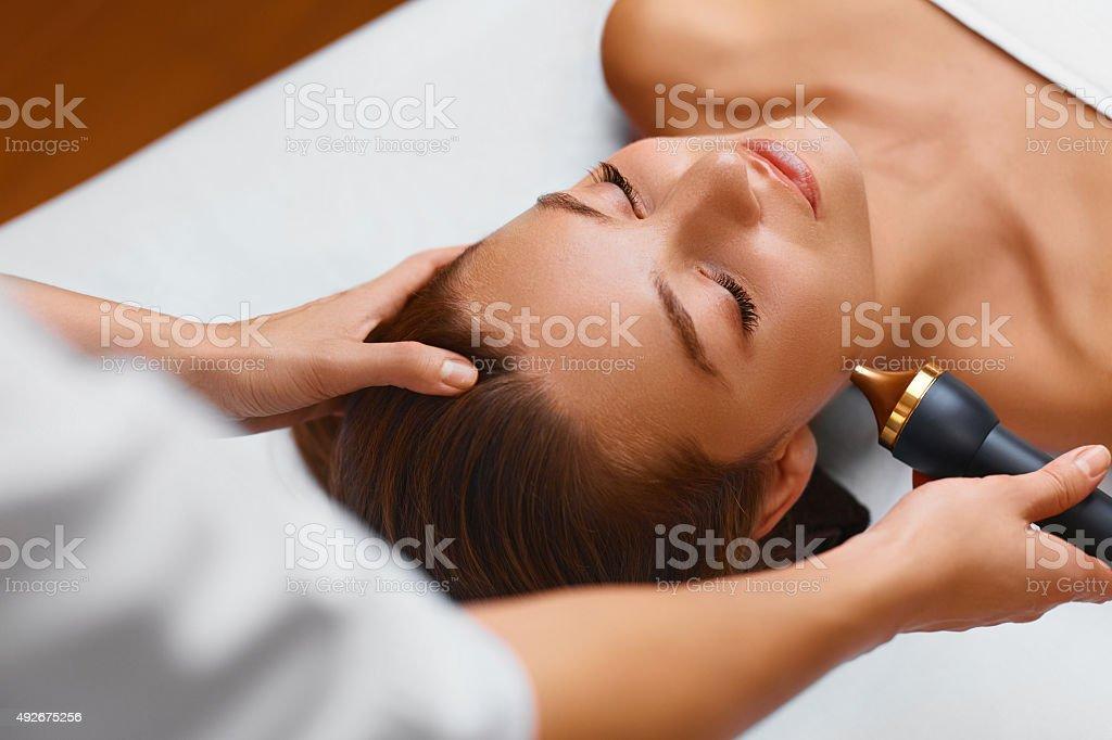 Face Skin Care Treatment. Ultrasound Cavitation Procedures. Spa Woman stock photo