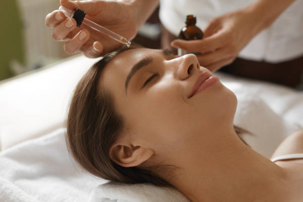 Face Skin Care. Woman Receiving Serum Treatment In Beauty Salon stock photo
