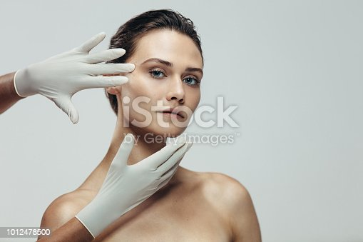 istock Face skin check before plastic surgery 1012478500